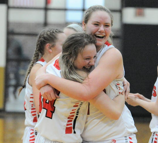 Baird players Kailey Isenhower, left, and Hannah Graham hug after beating Gorman in a Region III-1A bi-district playoff Tuesday at Clyde High School.