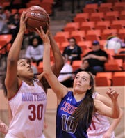 Lubbock Monterey's Kelly Mora (30) pulls down a rebound over Cooper's Brianna Garcia in the first half. Monterey beat the Lady Cougars 77-38 in the Region I-5A bi-district playoff game Tuesday, Feb. 18, 2020, at Howard College's Garrett Coliseum in Big  Spring.