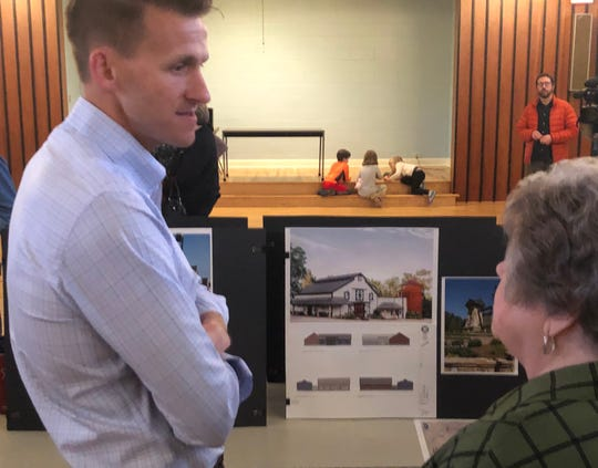 Developer Brian Wise, left, speaks with a resident about his proposal to put 687 residential units on an 82-acre former farm off Pond Road.