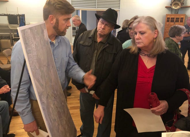 """Engineer Warren Sugg, left, with Civil Design Concepts, talks with Polly Jenkins about """"The Farm at Pond Road"""" apartment proposal on Feb. 18, 2020. Fall Line Development Inc. of Greensboro proposes building 687 residential units on an 82-acre property."""