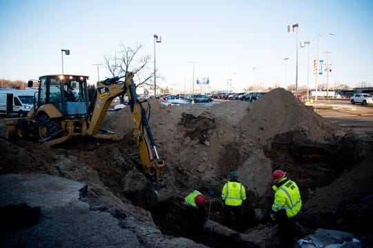Battle Creek water customers are under a boil advisory until further notice due to a significant leak on a 16-inch water main, pictured on Feb. 19, 2020 behind the former Kmart, near Capital Avenue Southwest and Dickman Road in Battle Creek, Mich.