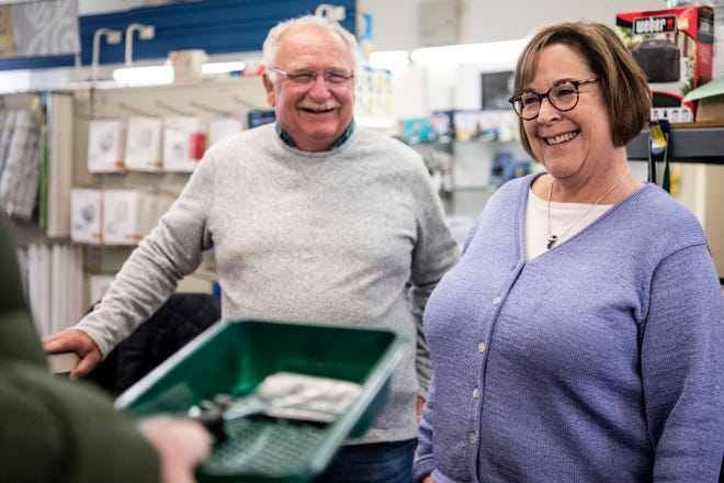 Craig Walters and Kerrie Redner, owners of Lakeview Hardware, share a laugh on Feb. 19, 2020 in Battle Creek, Mich. The 90-year-old hardware store is going up for sale.