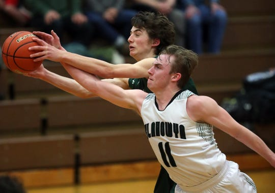 Klahowya's Preston Roberts (11)  tries to get a hand on a pass to Vashon Island's Zach VanDusen at South Kitsap High School in Port Orchard on Tuesday, Feb. 18, 2020.