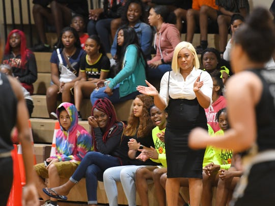 Cocoa coach Aisha Patrick applauds her team as it competes in the Class 4A girls basketball regional tournament. Patrick played in the 4A semifinal with Rockledge in 2008. Thursday, she will be back at state leading from the sideline.