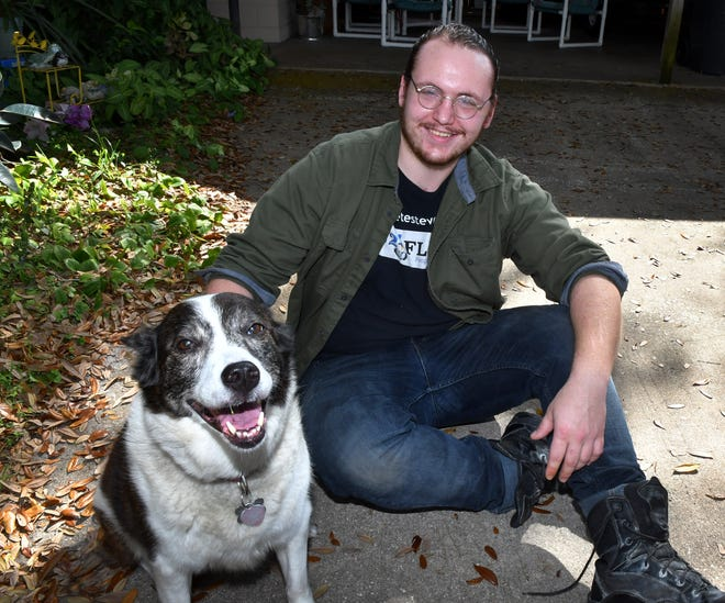 Micah Stubbe, 21, fought back against two men attempting a carjacking in Titusville on Tuesday. The assailants eventually gave up on getting his car, then attacked another man, and stole his vehicle. Photo shows Micah with Ellie, a friend's dog.