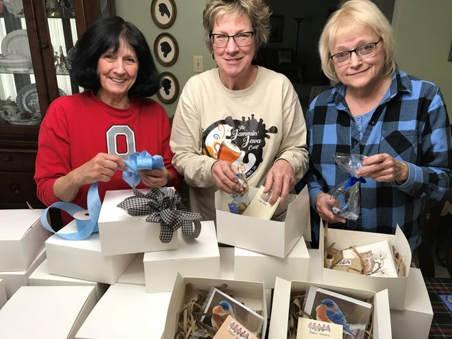 Earth, Wind and Flowers Garden Club members, from left, Mary Lee Minor, June Gebhardt and Judy Widman complete centerpieces for the Ohio Bluebird Society's conference. The conference will take place Feb. 29 at Ashland University's John  C. Myers Convocation Center.