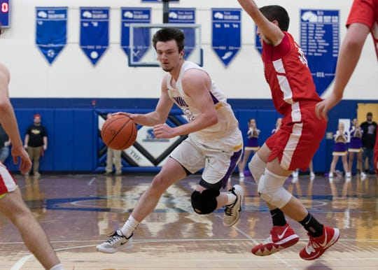 Unioto's Josh lambert dribbles the ball into the lane during a 45-39 win over Hillsboro in a  D-II sectional semifinal on Tuesday, Feb. 18 2020, at Southeastern High School in Chillicothe, Ohio.