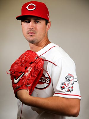 Cincinnati Reds starting pitcher Tyler Mahle (30) stands for a portrait, Wednesday, Feb. 19, 2020, at the baseball team's spring training facility in Goodyear, Ariz.