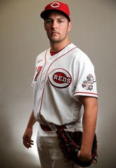 Cincinnati Reds starting pitcher Trevor Bauer (27) stands for a portrait, Wednesday, Feb. 19, 2020, at the baseball team's spring training facility in Goodyear, Ariz.