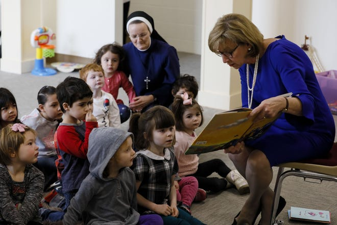 Ohio First Lady Fran DeWine reads to preschoolers on Tuesday, January 7, 2020 at St. John Paul II Early Childhood Center in Columbus, Ohio. [Joshua A. Bickel/Dispatch]