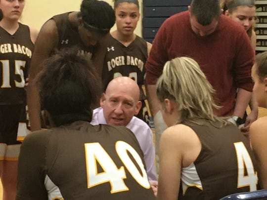 Roger Bacon girls coach Joe Finnegan coaches up the Spartans in the huddle