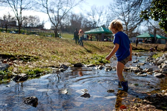Ronin Garlow, 6, walks across the small creek through the park on his day off at Valleybrook Park in Clarksville, Tenn., on Monday, Feb. 17, 2020.