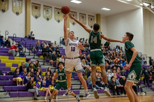 Andrew Turco scored his 1,000th career point as the No. 12 Monroe boys basketball team beat No. 21 J.F. Kennedy 60-48 to advance in the GMC Tournament
