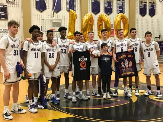 Andrew Turco (center with basketball) scored his 1,000th career point as the No. 12 Monroe boys basketball team defeated No. 21 J.F. Kennedy to advance in the GMC Tournament on Tuesday, Feb. 18, 2020.