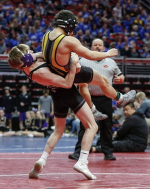 Waukee sophomore Tanner Smith pulls Bettendorf senior Jacob Faber down to the mat in their match at 113 pounds during the 2020 Iowa high school wrestling dual state tournament at Wells Fargo Arena in Des Moines on Wednesday, Feb. 19, 2020.