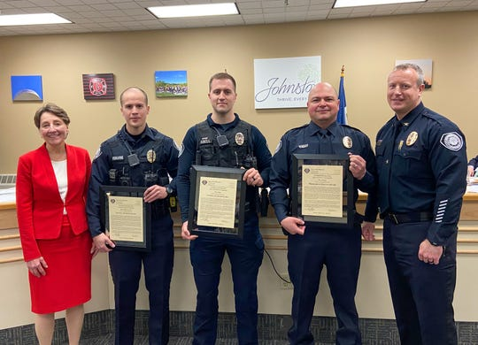 Pictured from left to right: Johnston Mayor Paula Dierenfeld, Officers Shane Mounlavong, Sam Abell, and Tony Trejo, and Police Chief Dennis McDaniel, at a city council meeting on Feb. 18, where the three officers received letters of commendation for their collaboration last summer to prevent a youth in crisis from jumping off a bridge.