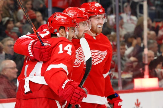 Feb 18, 2020; Detroit, Michigan, USA; Detroit Red Wings center Robby Fabbri (14) receives congratulations from teammates after scoring a goal in the second period against the Montreal Canadiens at Little Caesars Arena. Mandatory Credit: Rick Osentoski-USA TODAY Sports