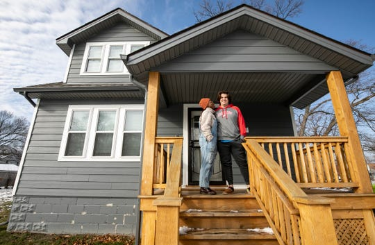 I'Sha Schultz-Spradlin 26, left, and Alex Schultz-Spradlin, 30, talk about the ups and downs of buying in to the, Fitzgerald neighborhood revitalization project Tuesday, Feb. 11, 2020.