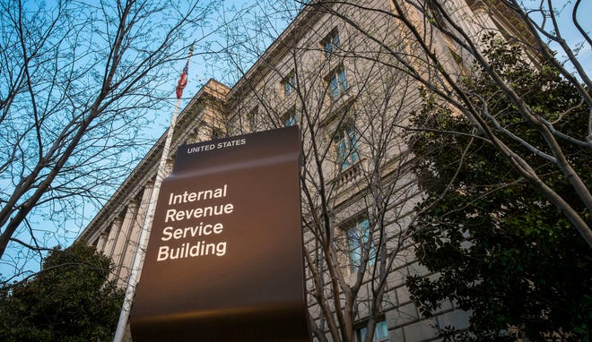 The IRS announced a move to step up efforts to collect taxes from high-income taxpayers who have failed to file tax returns in earlier years. File photo: This 2014 photo shows the Internal Revenue Service headquarters building in Washington, D.C.  (AP Photo/J. David Ake, File)