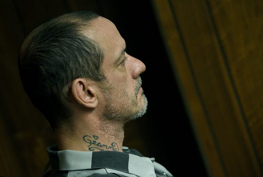 Kenny  McBride appears for a hearing, Wednesday morning, Feb. 19, 2020, in Monroe, Mich. McBride, 45, is charged with multiple felonies, including mutilation, in the murder of a 79-year-old Temperance woman who officials say was beheaded. (Tom Hawley/The Monroe News via AP)