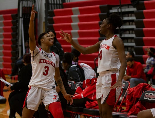 Gabrielle Elliott, (3), celebrates from the bench with teammate Ariel Jenkins (4), after Detroit Edison scored against Detroit Cass Tech., Tuesday, Feb. 18, 2020.