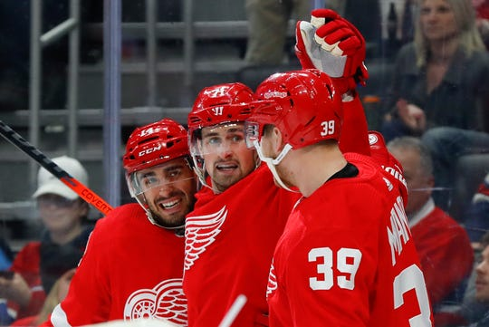 Detroit Red Wings center Robby Fabbri, left, celebrates his goal with Dylan Larkin and Anthony Mantha (39) during the second period of the team's NHL hockey game against the Montreal Canadiens, Tuesday, Feb. 18, 2020, in Detroit. (AP Photo/Paul Sancya)