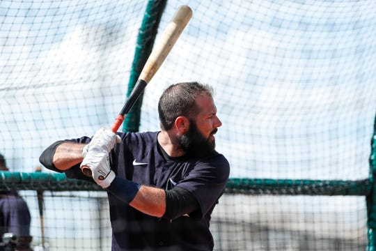 Catcher Austin Romine practices in the batting cage during Detroit Tigers spring training at TigerTown in Lakeland, Fla., Tuesday, Feb. 18, 2020.