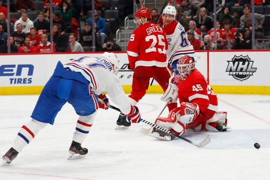 Detroit Red Wings goaltender Jonathan Bernier (45) deflects a shot by  Montreal Canadiens left wing Ilya Kovalchuk (17) during the third period on Feb. 18, 2020, in Detroit.