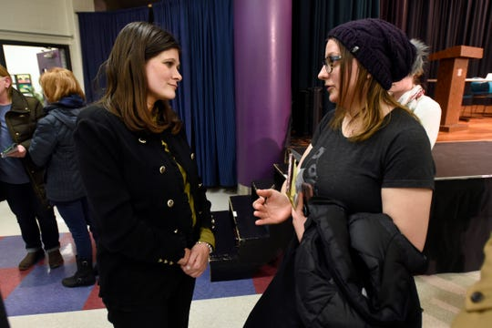 U.S. Rep. Haley Stevens, left, talks with Bethany Opelewski following a town hall discussion Tuesday in Wixom to address mental health issues, including suicide prevention and substance use.