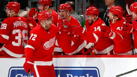 The Detroit Red Wings' Andreas Athanasiou is congratulated for his goal against the Montreal Canadiens during the third period.