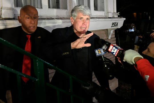 Former Illinois Gov. Rod Blagojevich waves to a supporter as he arrives home in Chicago on Wednesday, Feb. 19, 2020, after his release from Colorado prison late Tuesday.