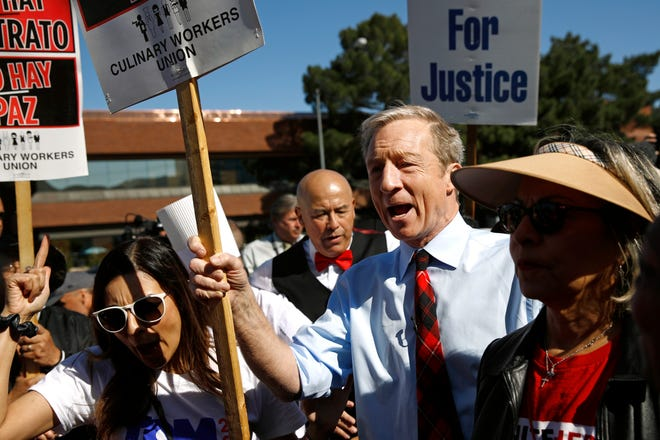Democratic presidential candidate, businessman Tom Steyer walks on a picket line with members of the Culinary Workers Union Local 226 outside the Palms Casino in Las Vegas, Wednesday, Feb. 19, 2020.