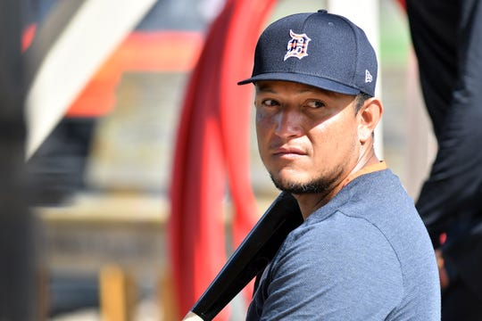 Tigers' Miguel Cabrera sits in the sun during batting practice.