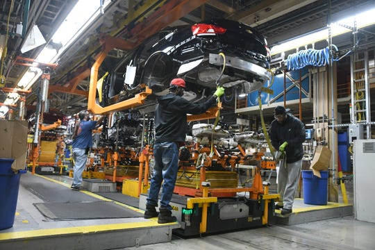Assembly line workers at the General Motors Detroit-Hamtramck plant continue working on the Chevrolet Impala as the plant will be converting from internal-combustion production to EV.