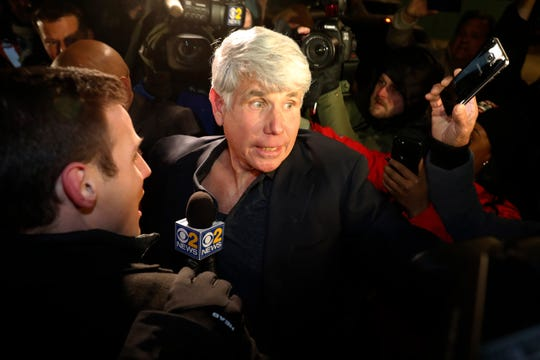 Former Illinois Gov. Rod Blagojevich tries to get into his house as he arrives home in Chicago on Wednesday after his release from Colorado prison late Tuesday.