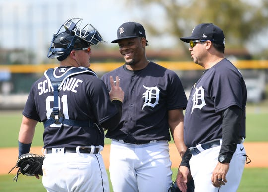 From left, catcher Kade Scivicque, pitcher Gregory Soto and coach Jorge Cordova talk after live batting practice session Tuesday in Lakeland, Florida.