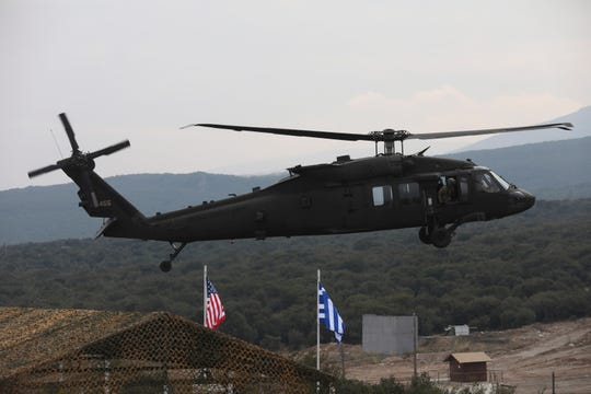 A helicopter takes part in a military drill in Litochoro, northern Greece, on Wednesday, Feb. 19, 2020.