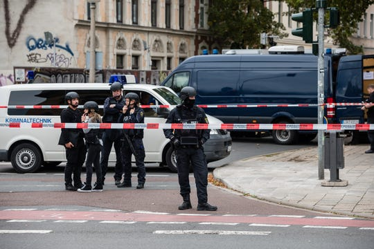 Police block access to a street near the scene of a shooting near a synagogue that left two people dead on October 9, 2019 in Halle, Germany.