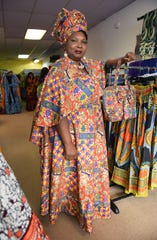 Owner Yemisi Bamisaye, wearing a maxi wrap dress, at her African Fashions by Classic Expressions store.
