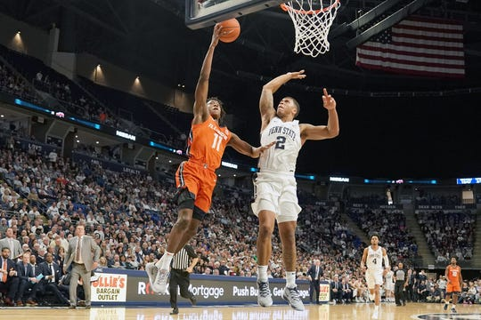 Illinois' Ayo Dosunmu (11) lays up a shot against Penn State's Myles Dread (2) in the second half.