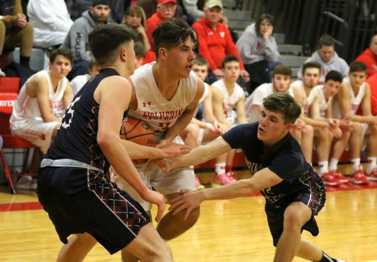 Aidan Westbrook of Waverly tries to keep the ball from Watkins Glen's Adam Pastore (left) and Isaac McIlroy during the Senecas' 60-50 win in an IAC South Large School boys basketball tiebreaker Feb. 18, 2020 at Waverly High School.