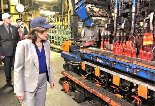 Lt. Gov. Kathy Hochul watches glass bottles being made Wednesday at Anchor Glass on McCann's Boulevard in Elmira Heights. Standing behind Hochul is plant General Manager Jason Achterberg.