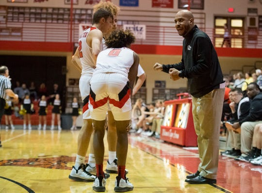 Princeton Head Coach LaMar Brown  gives direction as the Princeton Tigers play the Jasper Wildcats in Princeton, Ind., Tuesday evening, Feb. 18, 2020. The Jasper Wildcats beat the Princeton Tigers 39-36 making them the final Big Eight Conference champions.