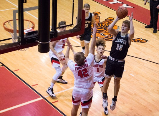 Jasper's Jackson Kabrick (15) takes a shot as the Jasper Wildcats play the Princeton Tigers in Princeton, Ind., Tuesday evening, Feb. 18, 2020. The Jasper Wildcats beat the Princeton Tigers making them the final Big Eight Conference champions.