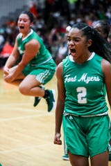 Fort Myer's' Janay Outten and Giovanna Santos celebrate a basket. Fort Myers beat Dunbar in their Class 6A regional semifinal girls basketball game.