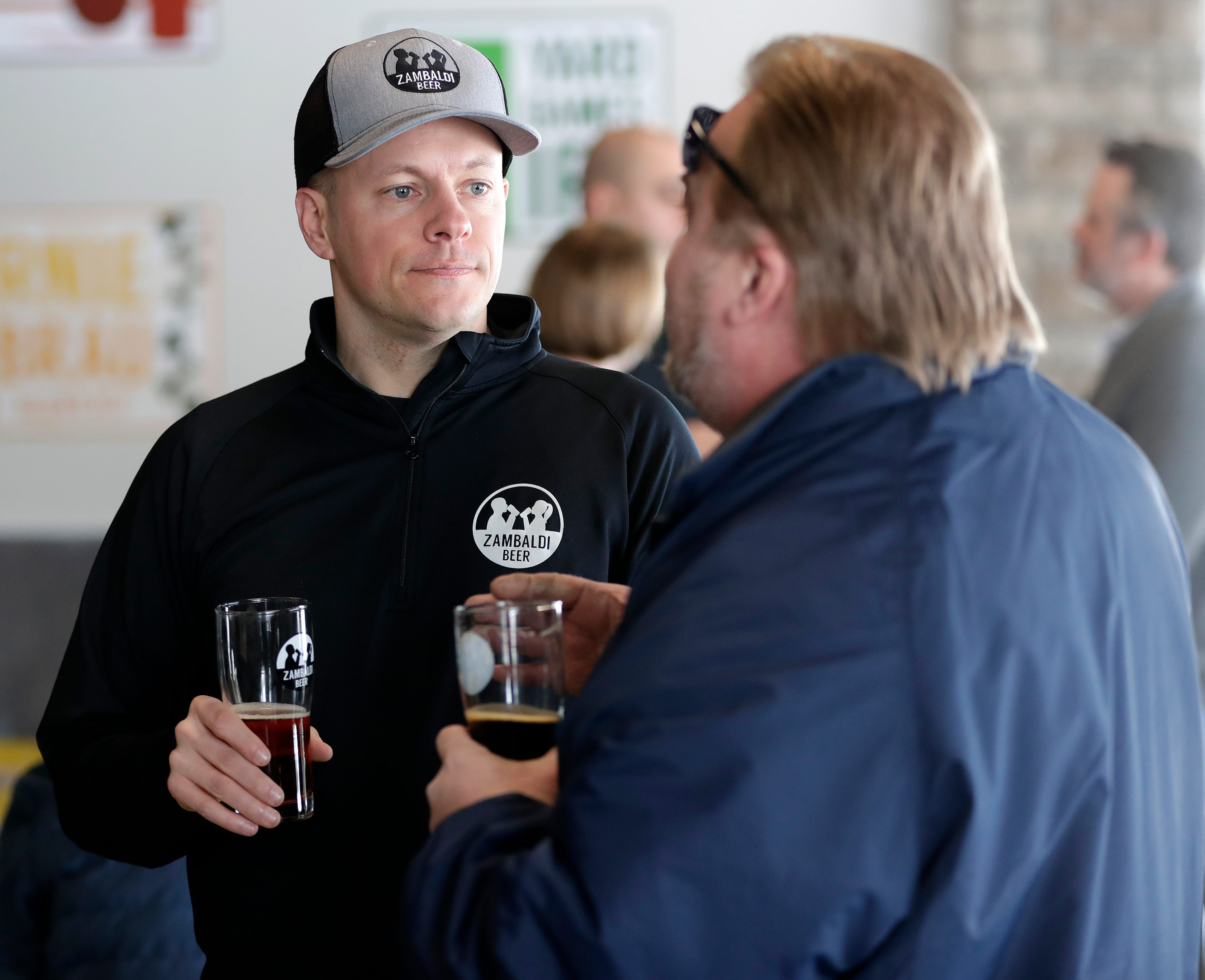 Wade Zander, a Zambaldi Beer founder and co-owner, talks with patrons during the brewery's grand opening in February. The brewery's name is a combination of Zander and Malcolm with baldi as a nod to Wade's and David's bald heads.