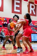 Greenville's J'Adore Young looks to make a shot guarded by Palmetto's Mercedes Watson  during their game Tuesday, February 18, 2020.