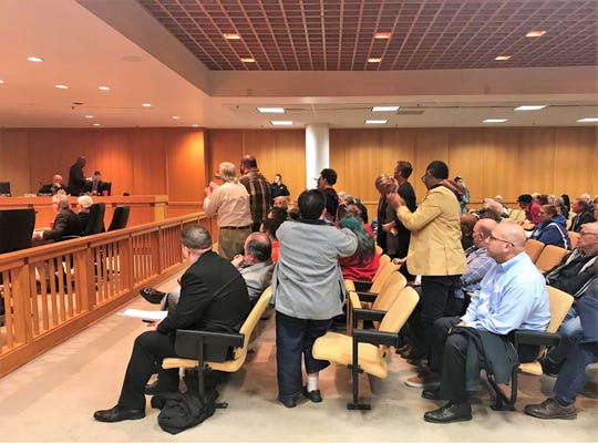 Audience members cheer Tuesday, Feb. 18, 2020, as Greenville County Councilman Ennis Fant walks out of a meeting over the 6-4 failure of his anti-bias ordinance.
