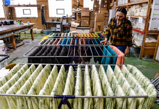 Candice English, owner of The Farmer's Daughter Fibers, talks about the freshly dyed yard air drying in her processing facility in Great Falls.