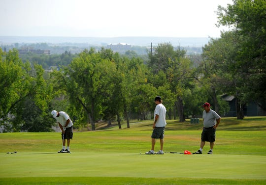 A group of golfers are shown enjoying a round at Anaconda Hills Golf Course last season. The four courses in Great Falls will be open for limited business once the weather thaws out and the course are playable.